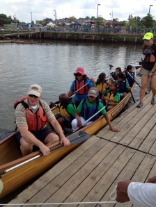 Mayor of Saint Paul Chris Coleman mans the bow of his Voyageur canoe with his excited team from Prince George's County Parks and Recreation Summer Programs