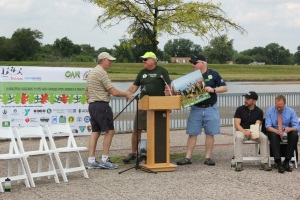Greg Lais of Wilderness Inquiry presents an award to Saint Paul Mayor Chris Coleman, who is also President of the National League of Cities. A recent partnership between the Department of the Interior, National League of Cities and the YMCA of the USA aims to connect urban youth to the outdoors.