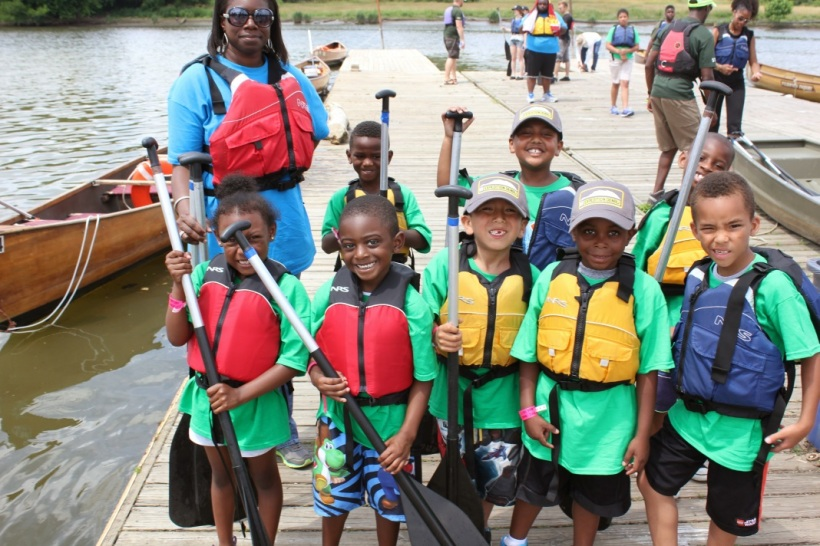 Wilderness Inquiry outfitted over 400 people with PFDs and paddles to get ready to explore the river in 24' Voyageur canoes