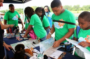 Young environmentalists learn about local wilderness with maps and wildlife trading cards provided by the National Parks Conservation Association