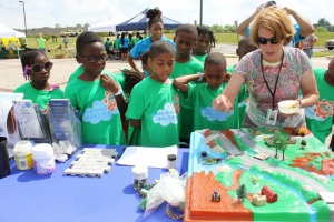 Head of Prince George's County's Community Outreach Promoting Empowerment Section, Deborah Weller leads an interactive demonstration on how community activities affect the watershed and what residents can do to help our local waterways.