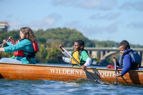 Parent and two kids canoeing along the Potomac River